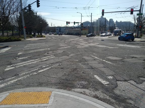 Huge intersection with pavement in bad shape