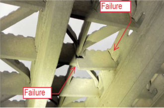 Photo showing a cracked section of bridge decking.