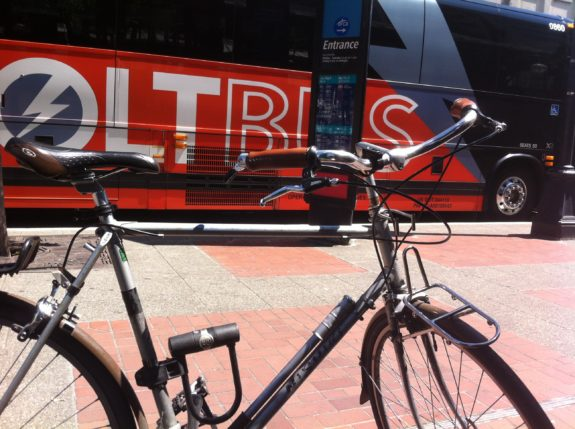 A bicycle in front of a BoltBus.