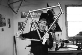 Max holding a bike frame.