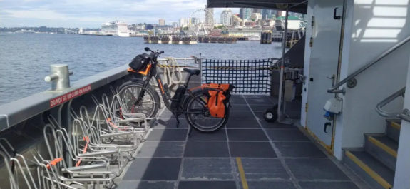 Photo of a bike with wide tires secured in the Water Taxi bike section.
